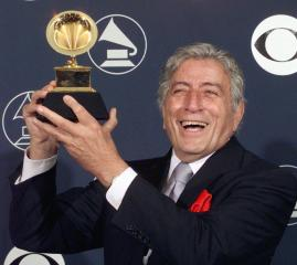 Singer Tony Bennett holds his Grammy Award 25 Febr