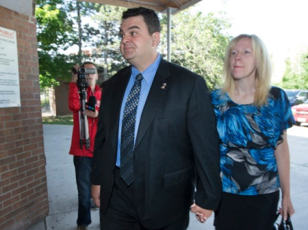PETERBOROUGH, ONT.: JUNE 23, 2014 -- Dean Del Mastro and his wife, Kelly, arrives at the Provincial courthouse in Peterborough for the first day of his trial on Elections Act charges. (Peter Power for Post Media News) ORG XMIT: 00030057A ORG XMIT: POS1406230854598072