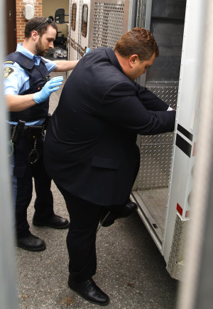 former MP Dean Del Mastro is led away in handcuffs and shackles on Thursday June 25, 2015 at Simcoe St. Courthouse in Peterborough, Ont. Del Mastro, 44, was sentenced to a month in jail Thursday in Peterborough court after he was convicted on four Elections Canada charges. Clifford Skarstedt/Peterborough Examiner/Postmedia Network ORG XMIT: POS1506251351353996  // 0626 del mastro live