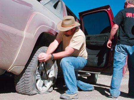 man fixing flat tire